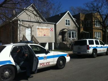 Police respond Sunday to the scene of a triple shooting in the 7400 block of South Champlain Avenue.