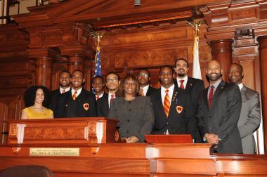 State Sen. Mattie Hunter (D-Chicago) (middle) is joined by seniors attending Urban Prep Academy for Young Men High School in the chambers of the Illinois General Assembly on Thursday, April 18, 2013. Sen. Hunter invited the students to Springfield to honor them for maintaining a 100 percent college acceptance rate for the last four years.