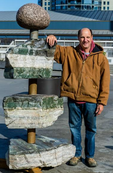 Artist Jeffrey Breslow installed a new sculpture on the East Bank Club this week.
