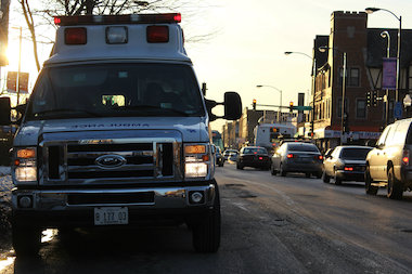 Ambulances respond to the scene of a crash involving a van carrying kids and another car, authorities said. (file photo)