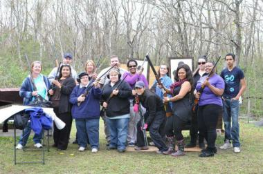 A group of Armed Citizens Project participants pose with their guns.