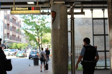 "A cop walks past the Belmont ""L"" stop. The area around the train station is known to attract crime, police have said."