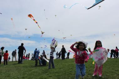 The city's 15th annual kite festival brought out thousands of parents and children to Lincoln Park's Cricket Hill Saturday.