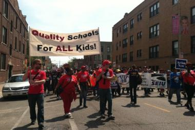 Supporters of the Chicago Teachers Union march against the closure of 54 public schools on Saturday, May 18, 2013.