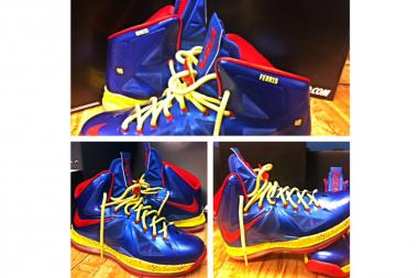 "Clinton Shepherd's custom-made, Superman-colored gym shoes with ""Ferris"" and ""48"" emblazoned to commemorate his effort."