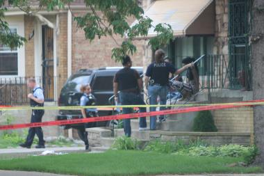 Police investigate the scene of a fatal shooting in Auburn Gresham.