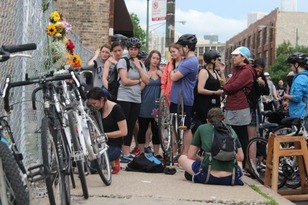Hundreds of 'Critical Mass' cyclists paused along their route Friday evening to remember avid rider Bobby Cann, who was struck by a car and killed while riding his bike Wednesday.