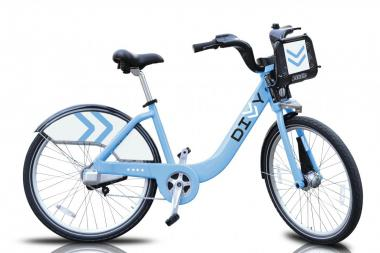 "The ""Divvy"" bike is a three-speed hybrid painted in ""Chicago Blue."""