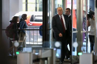 Donald Trump arrives at the Dirksen Federal Courthouse to testify in a civil case involving his Trump Tower on May 14, 2013, in Chicago, Illinois. Jackie Goldberg, 87, has accused Trump of conning her during the purchase of two condo units in Trump Tower, a hotel and condo building which Trump developed along the Chicago River.
