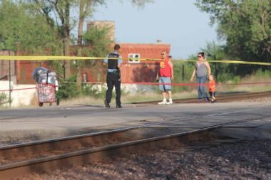 Neighborhood residents fear for safety of students crossing tracks between closing school and welcoming school.