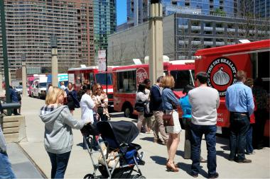 People line up Wednesday for food trucks at Cityfront Plaza.