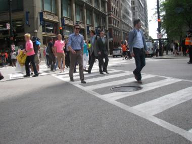 CDOT Commissioner Gabe Klein tries out the new all-way crosswalk at State and Jackson Friday morning.