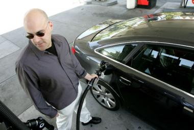The switch to an environmentally friendly summer fuel blend is one reason Chicago drivers are paying more at the pump.