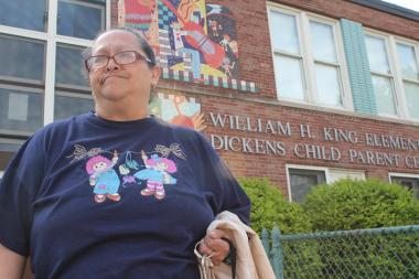 Maria Cortes, who has taught at King Elementary for 22 years, stands outside of the school, which is slated to close in the fall.