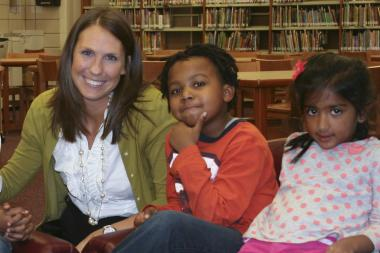 Lauren Albani, seen with children at Skinner North Classical School in July of 2011. She served a principal internship there.