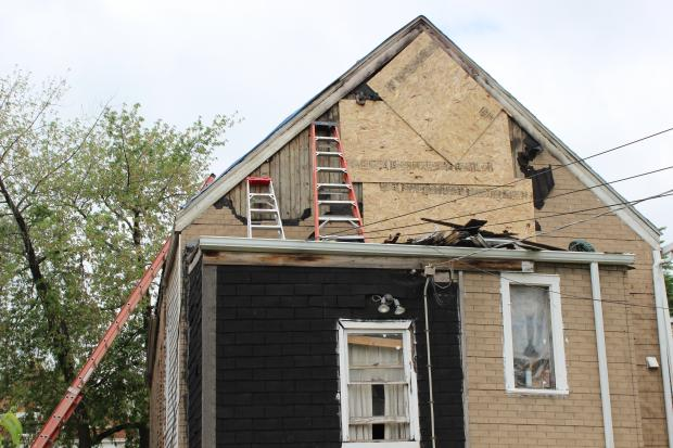 Neighbors said a bolt of lightning started a fire overnight Monday in the city's Little Village neighborhood.