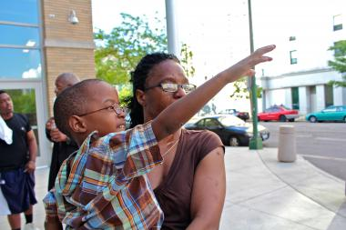 Tears pour down Manierre parent Shereena Allison's face shortly after learning that the school would not be closed. She's holding her 5-year-old son TaVaughn Allison.