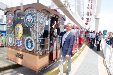 Mayor Rahm Emanuel shakes Clinton Shepherd's hand on Saturday, the day Shepherd set a world record for consecutive rides on a Ferris wheel.
