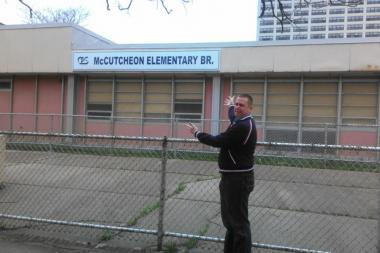 Lyman Trumbull Elementary School parent and Local School Council Chairman James Morgan outside James McCutcheon Elementary School's annex building, which he is not thrilled about.