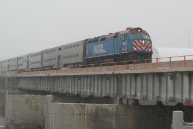 A Metra train crosses a bridge over the Dan Ryan Expressway in Englewood.