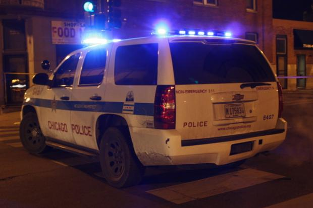 The woman was walking to a friend's house around 7:30 p.m. in Logan Square when she was robbed at gunpoint, police said.