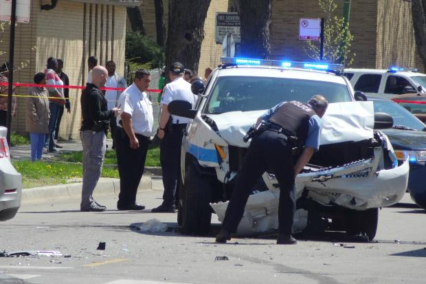 A woman died in a crash in South Shore that also injured two police officers and another civilian, police said.