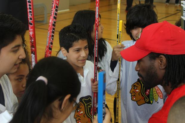 U.S. Rep. Mike Quigley and NHL Hall of Famer Denis Savard played hockey with Burr Elementary students in Wicker Park Tuesday. Quigley, Savard and students all agree the Blackhawks will pull out a win in Wednesday's Game 7 at the United Center.