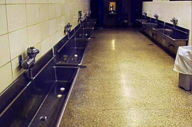 Wrigley Field may get a restoration, but the old men's trough urinals will stay.