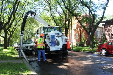 A city crew Friday cleaned out a catch basin in the 6300 block of Paulina Street that had been clogged for months.