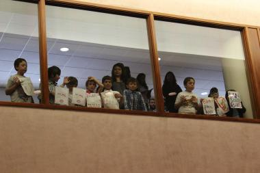 Third-graders from the Audubon School urge passage of the plastic bag ban from the City Council gallery.