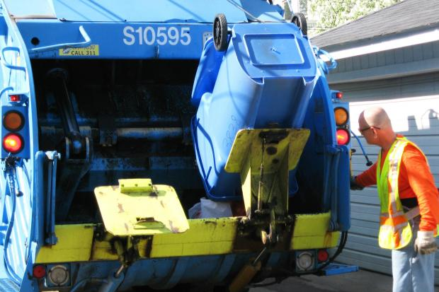 Blue carts will soon pop up in 10 more neighborhoods as part of the city's plan to expand recycling across the city in 2013.