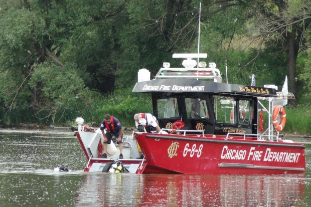 Officials rescued one man and pulled another from the Calumet River Tuesday afternoon, authorities said.