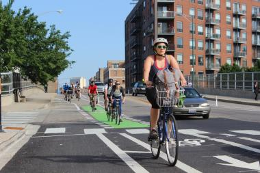 A stretch of protected bike lanes on Milwaukee Avenue features bike traffic signals and the first bike passing lane. (File Photo)