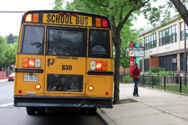 A bus brings students to Mayo Elementary on the last day of school.