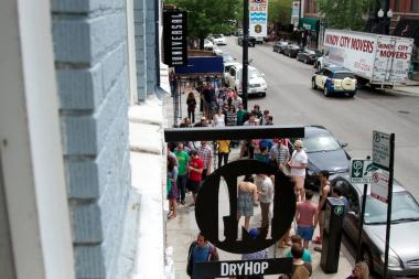 People crowd outside DryHop Brewers, 3155 N. Broadway.