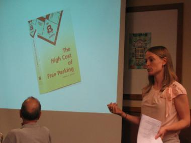 "CMAP's Lindsay Bayley extolls the virtues of UCLA professor Donald Shoup's book, ""The High Cost of Free Parking,"" at a meeting on parking issues in Wicker Park Wednesday evening."
