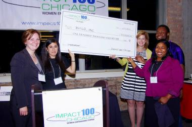 BUILD, Inc. receives the $100,000 check from the City Chapter of Impact 100 Chicago. Included in the photo are: Nicole Seidlitz, City Chapter Grants Chair; Georgy Ann Peluchiwski, City Chapter Co-founder; Allison Bacon, City Chapter Co-founder; Aramis Pates, BUILD, Inc. Youth; and Dr. Roslind Blasingame-Buford, BUILD, Inc. Executive Director.