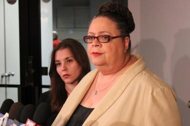 CTU president Karen Lewis and Kristine Mayle, CTU financial secretary, speak to the media about the 855 layoffs announced by CPS on Friday, June 14, 2013.