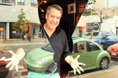 Virgin Mobile Area manager Kevin Brenna could only throw up his hands after Blackhawks fans busted the store's front window. The repair could cost as much as $900.