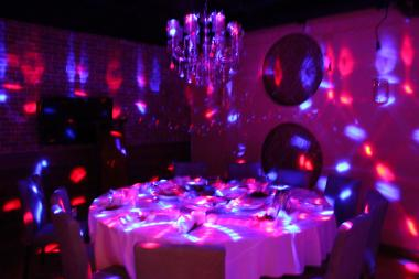 Diners look for a full-on party can turn off the lights and switch on the glowing disco ball.