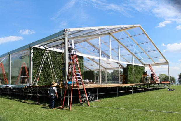 A massive stage and tent are being erected at Promontory Point for a party celebrating the wedding of filmmaker George Lucas and Chicago's Mellody Hobson.