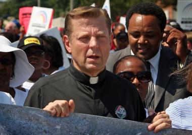 The Rev. Michael Pfleger, pastor of St. Sabina Church in Auburn Gresham, is one of five members of a panel who will search for a new leader to monitor alleged police misconduct.
