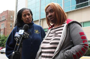 Tynisha Hilliard, right, talks to the media Wednesday outside Comer Children's Hospital, where her 9-year-old son, Tykeece, was being treated for a gunshot wound. (File photo)