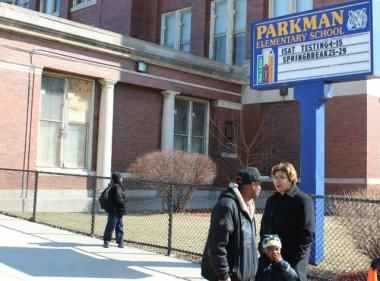 Parkman Elementary School principal Sonja James talks with a parent outside the school in March.