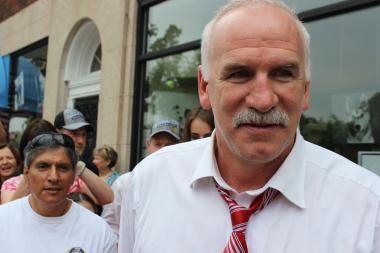 Blackhawks Coach Joel Quenneville greets fans outside Page's restaurant in Hinsdale.