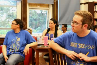 Roosevelt High School staff members attend a local school council meeting to discuss the school's budget cuts.