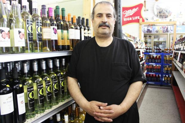 A more upscale liquor store could replace Isam's Liquor Store despite the owner's willingness to change his ways.