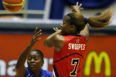 USA's Sheryl Swoopes (right) jumps to take control of the ball with Leidis Oquendo Valdes of Cuba during their FIBA World Championship for Women in 2006. Swoopes, arguably one of the greatest women's basketball players ever, is the new head coach at Loyola University.