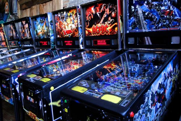 Pinball machines line the wall of Emporium Arcade Bar in Wicker Park
