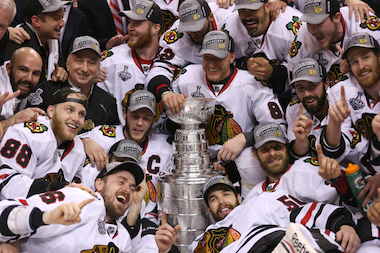 The Blackhawks celebrate with the Stanley Cup after beating Boston 3-2 in Game 6 of the Stanley Cup Final on Monday. (File photo)